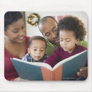 Black family reading book together mouse pad