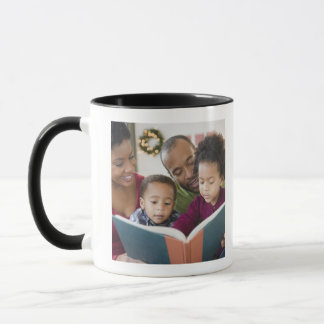 Black family reading book together mug