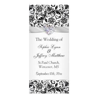 Black floral swirls on silver Wedding Program