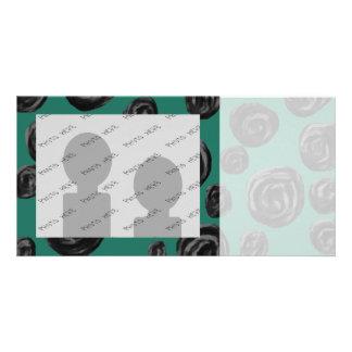 Black flowers on jade green. card