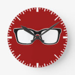 Black framed glasses wall clock