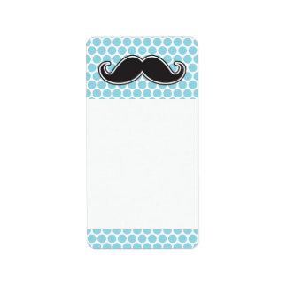Black handlebar mustache on blue polka dot pattern label