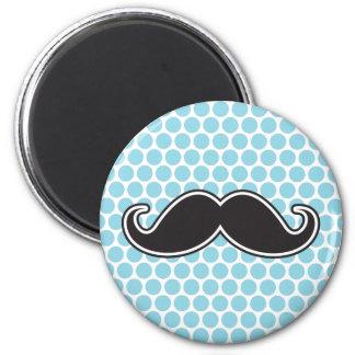 Black handlebar mustache on blue polka dot pattern magnet