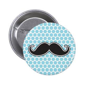 Black handlebar mustache on blue polka dot pattern pinback button