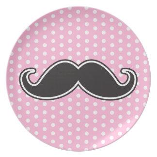 Black handlebar mustache on girly pink polka dots plate