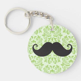 Black handlebar mustache on green damask pattern keychain