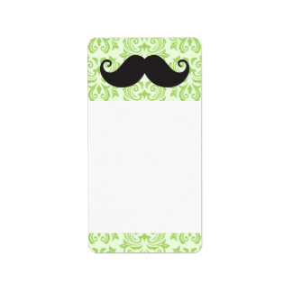 Black handlebar mustache on green damask pattern label