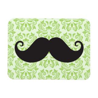 Black handlebar mustache on green damask pattern magnet