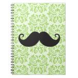 Black handlebar mustache on green damask pattern spiral notebooks