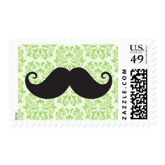 Black handlebar mustache on green damask pattern stamps