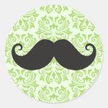 Black handlebar mustache on green damask pattern round stickers