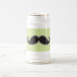 Black handlebar mustache on lime green polka dots beer stein