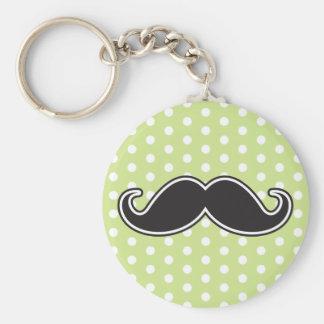 Black handlebar mustache on lime green polka dots keychain
