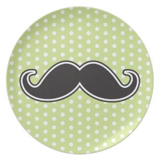 Black handlebar mustache on lime green polka dots melamine plate
