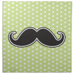 Black handlebar mustache on lime green polka dots cloth napkin