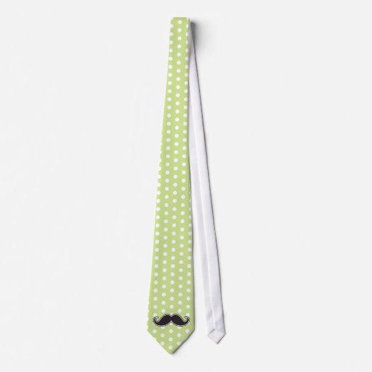 Black handlebar mustache on lime green polka dots tie