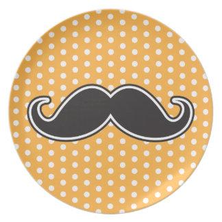 Black handlebar mustache on orange polka dots dinner plate