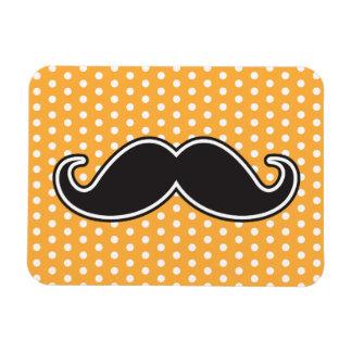 Black handlebar mustache on orange polka dots magnet