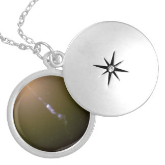 Black Hole-Powered Jet of Electrons and Sub-Atomic Round Locket Necklace