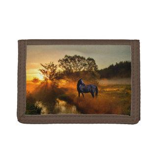 Black horse at sunrise or sunset tri-fold wallet