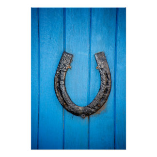 black horseshoe on a blue door poster