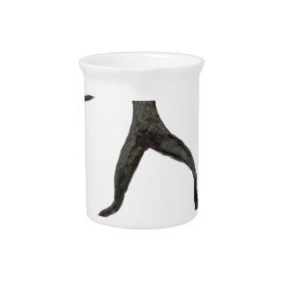 Black human wax model on white background drink pitcher