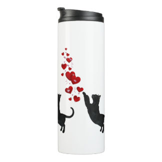 Black kitty cat plays with love thermal tumbler
