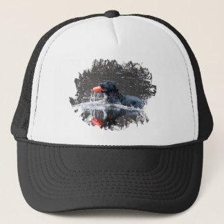 Black lab fetching floatie trucker hat
