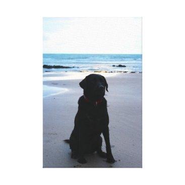 Beach Themed Black Labrador on a beach Canvas Print