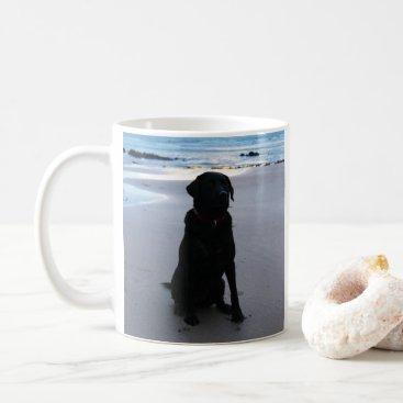 Beach Themed Black Labrador on a beach Coffee Mug