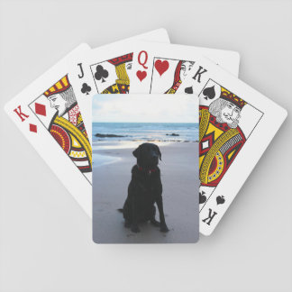 Black Labrador on a beach Playing Cards