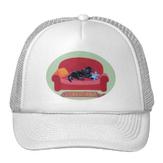 Black Labrador on the pink couch Trucker Hat
