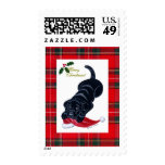 Black Labrador Puppy & Santa Hat Christmas Postage Stamps