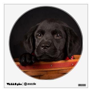 Black labrador retriever puppy in a basket wall sticker