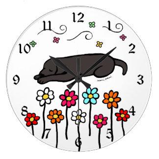 Black Labrador Sleeping in the Garden Large Clock