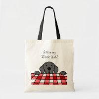 Black Labrador watching you bag