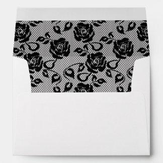 Black lace pattern on white background envelope