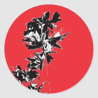 Black Leaves on Red Background Classic Round Sticker