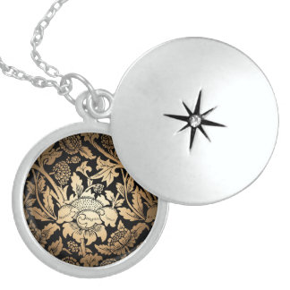 Black lion with flame on a shield  with wings round locket necklace