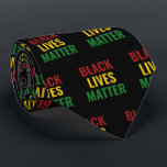 """BLACK LIVES MATTER BLM Red Yellow Green BHM Neck Tie<br><div class=""""desc"""">Stylish BLM TIE with vibrant red,  yellow and green typography which says BLACK LIVES MATTER against a rich black background. MONOGRAM version also available. Part of the BLACK HISTORY MONTH Collection.</div>"""