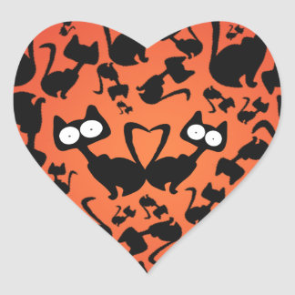 Black magic cat pattern on a red background heart sticker