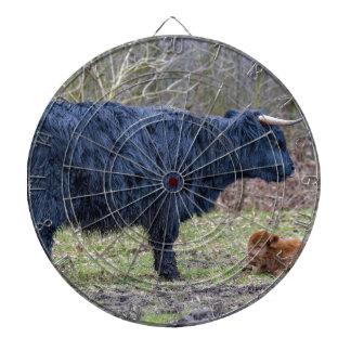 Black mother scottish highlander cow with calf dartboard