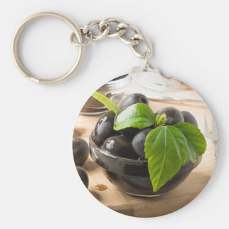 Black olives in glass cups with oil keychain
