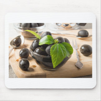 Black olives in glass cups with oil mouse pad