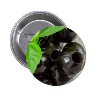 Black olives, pitted marinated in a glass bowl pinback button