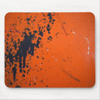 Black paint splatter on orange mouse pad