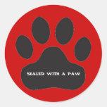 Black Paw Print on Red Background Classic Round Sticker