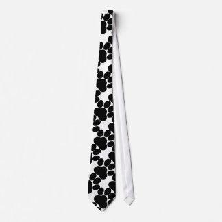 Black paws on white neck tie