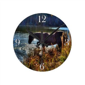 Black Percheron Stallion Playing at Lake's Edge Round Clock