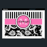 "Black, Pink, White Stripe Damask Laptop Skin<br><div class=""desc"">This chic personalized black and white striped with floral damask pattern laptop skin has a pink band a round area with template boxes for you to personalize with your name, initials, monogram, or other text. ***PLEASE note that if you change the computer make and model that it MAY alter the...</div>"